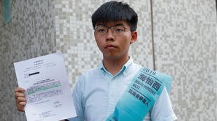 Joshua Wong, secretary-general of Hong Kong's pro-democracy Demosisto party, poses before submitting his application for the 2019 District Council Election in Hong Kong on October 4, 2019.
