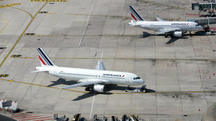 This file photo taken on June 27, 2019 shows two Air France aircraft on the tarmac of Roissy-Charles de Gaulle Airport north of Paris, France.