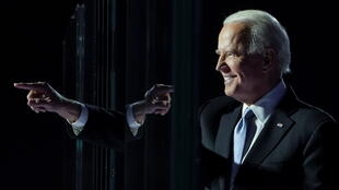 Democratic 2020 US president-elect Joe Biden gestures from the stage at his rally in Wilmington, Delaware,  November 7, 2020.