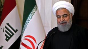 Le président iranien Hassan Rohani s'exprimant lors d'une conférence de presse conjointe avec son homologue irakien, à Bagdad le 11 mars 2019.
