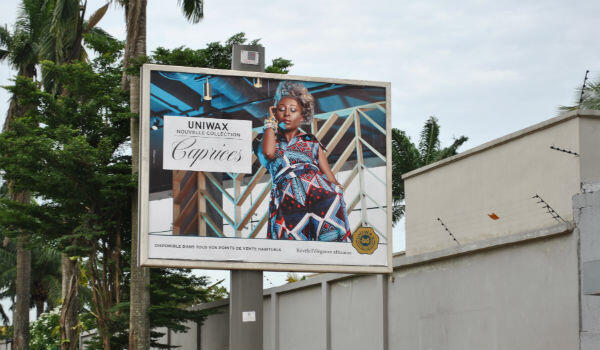 A billboard in Ivory Coast's Abidjan for one of several brands owned by Anglo-Dutch group Vlisco.