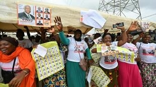 Women take part in Ivory Coast's parliamentary campaign rally in the popular district of Yopougon, a suburb in Abidjan, on March 3, 2021.