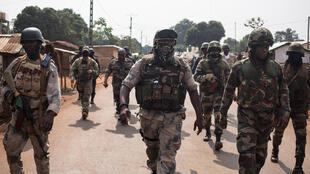 Soldiers of the Central African Armed Forces patrol near the border in Boali, CAR, on January 10, 2021.