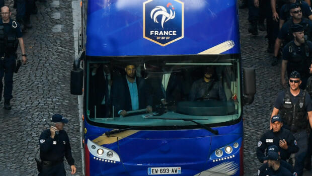 Élysée Chief Security Officer Alexandre Benalla is seen in the driver cabin (front L) of the bus carrying France's World Cup winning football players as they arrive on the Champs-Élysées in Paris on July 16, 2018.