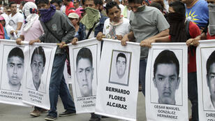 Protesters march in Acapulco, on October 17, 2014, to demand answers over the fate of 43 missing students
