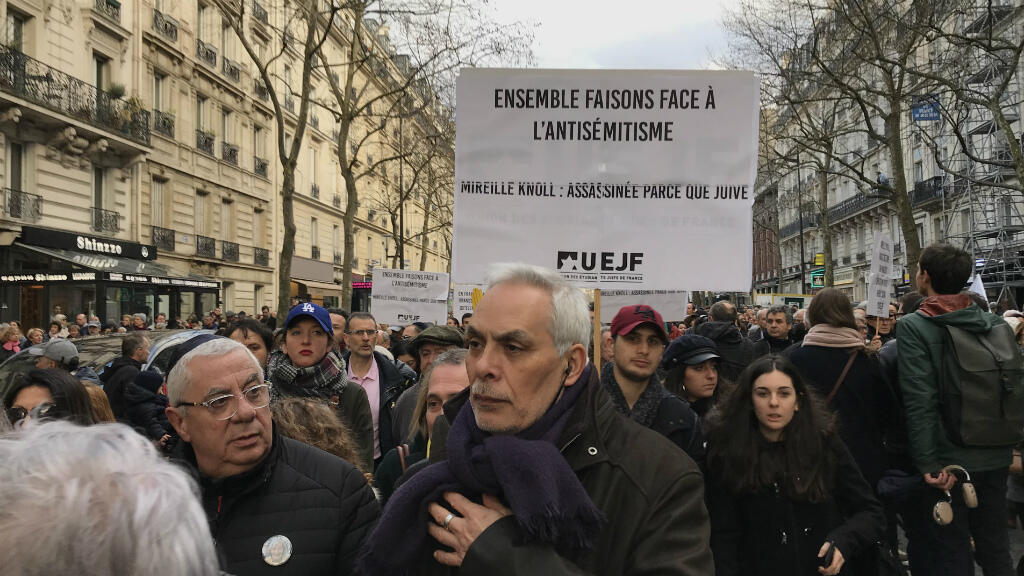 """""""Together, we confront anti-Semitism"""", reads banner at Mireille Knoll memorial march"""