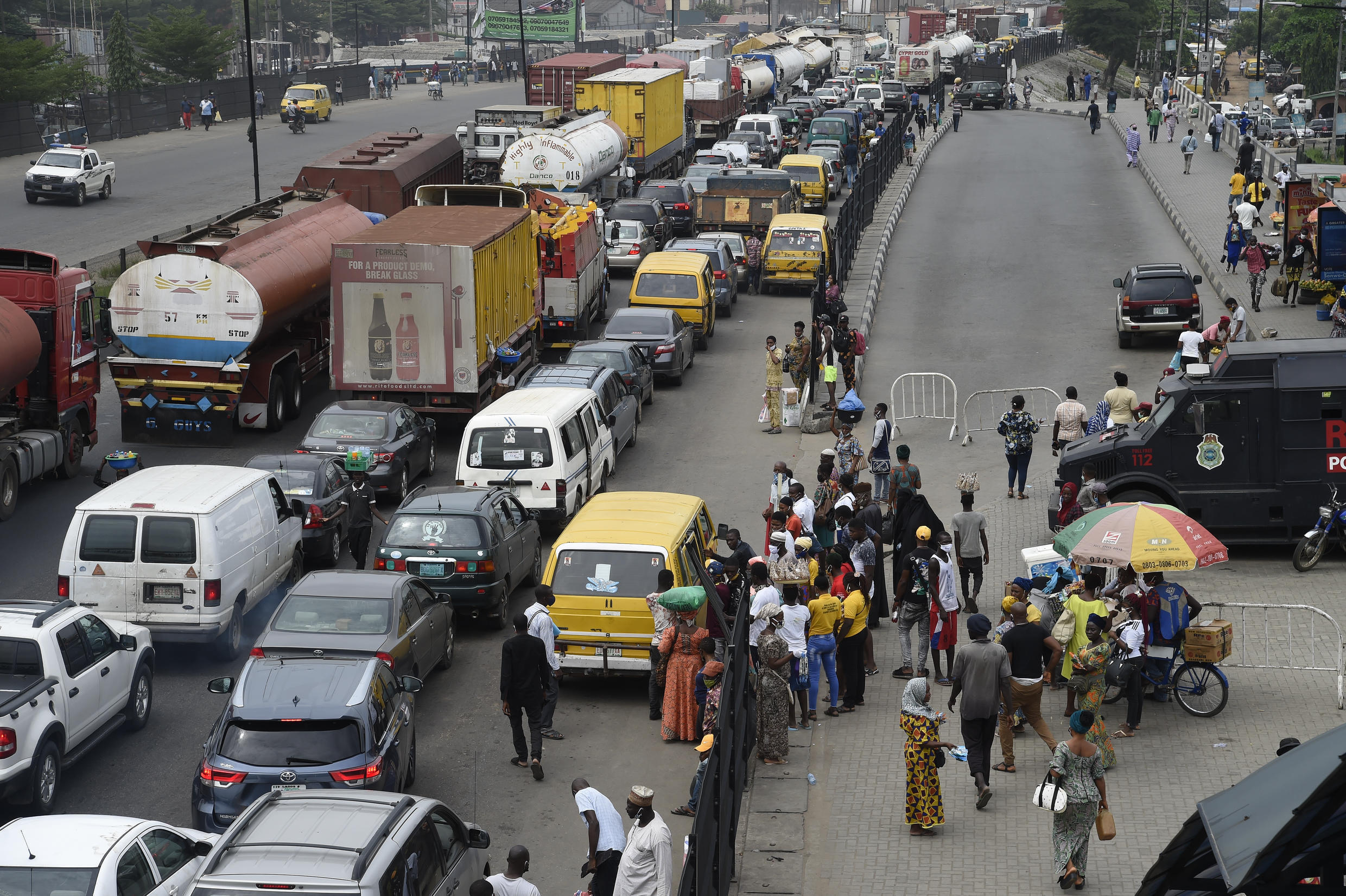 Nigerians take to the roads again in Lagos on May 4, 2020, after five weeks in lockdown over the coronavirus outbreak.