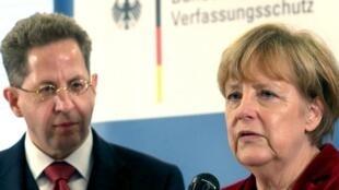 Hans-Georg Maassen (izquierda) y Angela Merkel, 10 de octubre de 2014 en Colonia, Alemania.