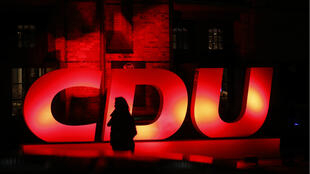 An illuminated logo of the Christian Democratic Union (CDU) party in front of the conference venue, the International Maritime Museum, in Hamburg, Germany, on January 17, 2020.