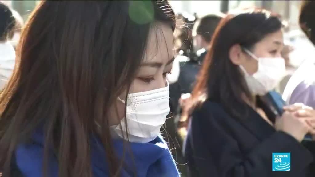 2021-03-11 11:01 Japan falls silent to mark decade since Fukushima disaster
