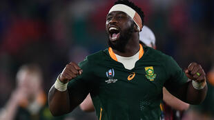 South Africa captain Siya Kolisi celebrates winning a 2019 Rugby World Cup semi-final against Wales in Japan.