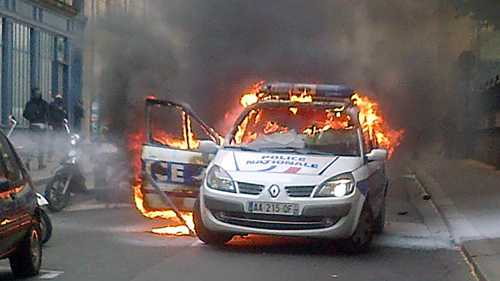 Crowd Sets Police Car Alight At Law Enforcement Rally In Paris