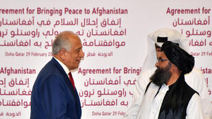 (L to R) US Special Representative for Afghanistan Reconciliation Zalmay Khalilzad and Taliban co-founder Mullah Abdul Ghani Baradar shake hands after signing a peace agreement during a ceremony in the Qatari capital Doha on February 29, 2020 (Photo by Giuseppe CACACE / AFP)