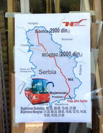 Posters advertise bus rides to Subotica, on the border with Hungary. (Photo: Fernande van Tets)