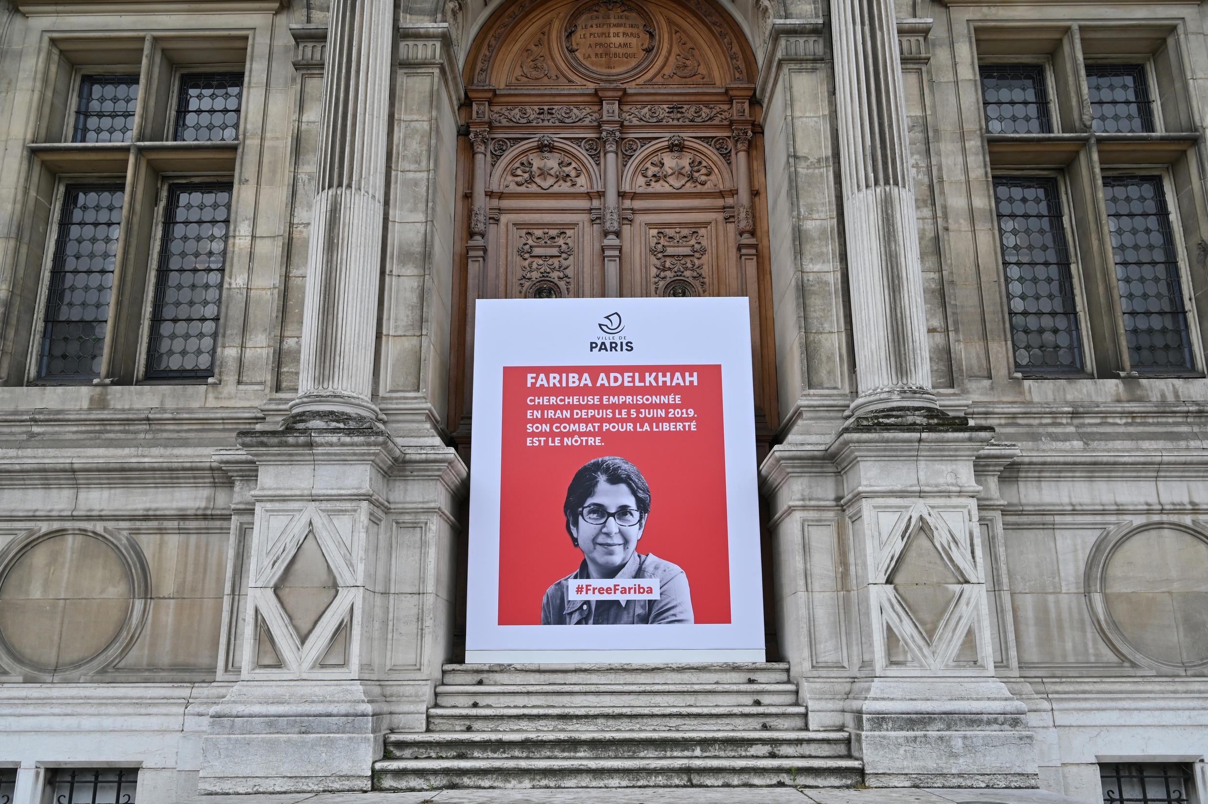 A placard with a portrait of French-Iranian academic Fariba Adelkhah, imprisoned in Iran, is placed outside Paris's city hall on June 5, 2020.