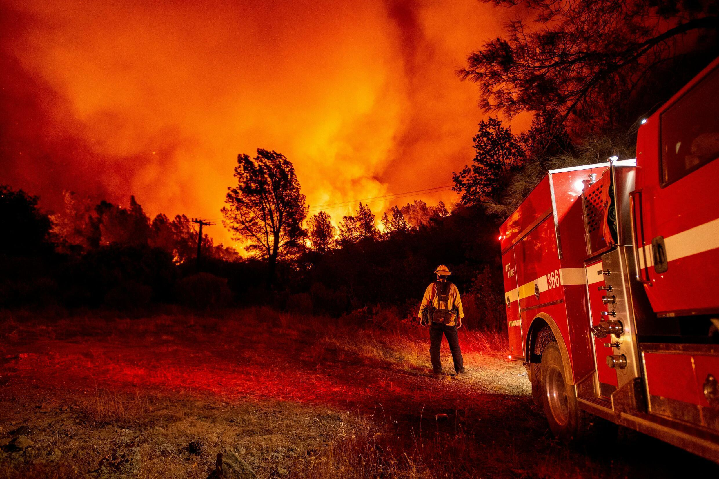 Firefighters fight fire north of Lake Oroville in California in September 2020