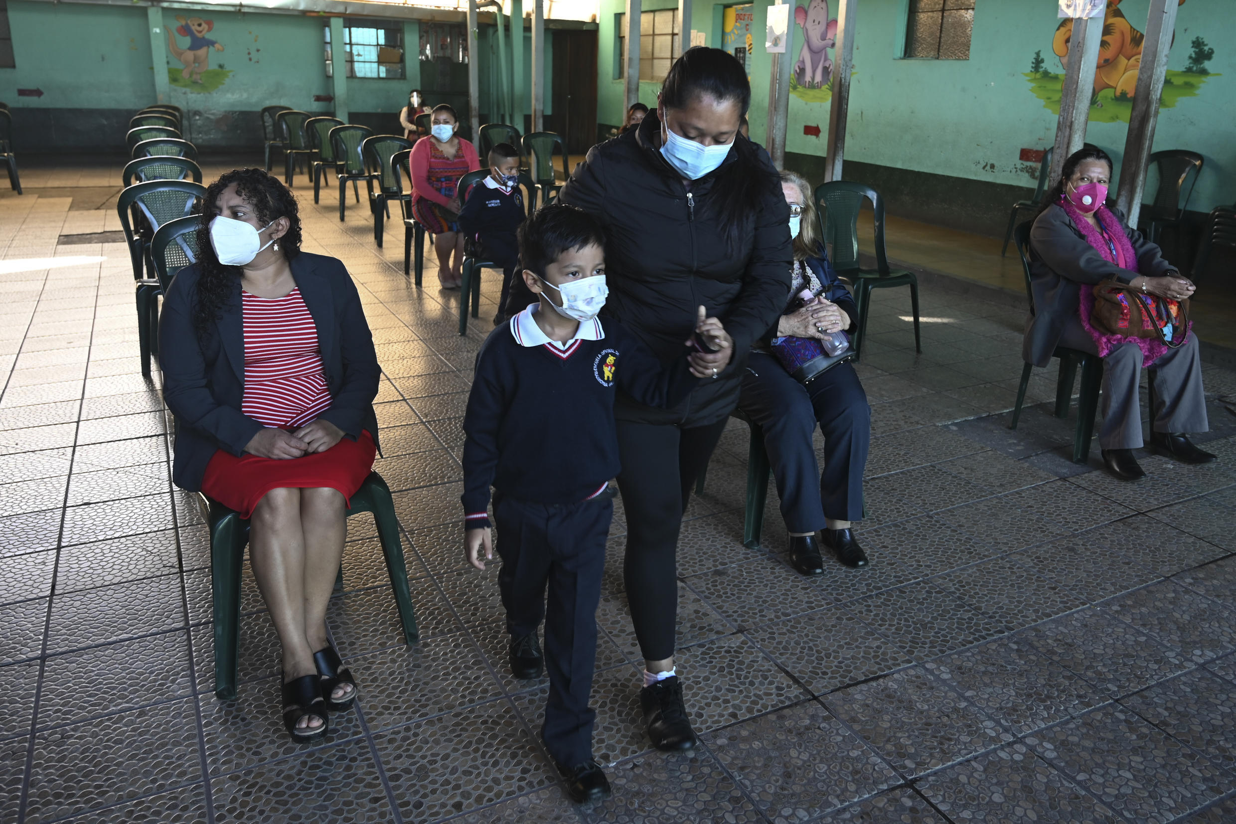 A child wears a mask as a precaution against the contagion of covid-19, while attending the start of classes ceremony at the Ramona Gil School in Chimaltenango, 60 kilometers west of Guatemala City, on February 22, 2021