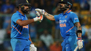 Virat Kohli (R) and Rohit Sharma are both based in hard-hit Mumbai