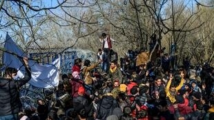 Migrants demonstrate on the Turkey-Greece border buffer zone, near the Pazarkule crossing gate in Edirne, Turkey, on March 6, 2020.