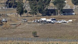La frontière syro-israélienne vue du village de Ein Zevan, une colonie israélienne, dans le Golan occupé, le 26 juillet 2018