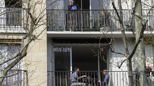 Photo taken March 28, 2020 of Parisians on a balcony during France's first lockdown from March 17 to May 11.
