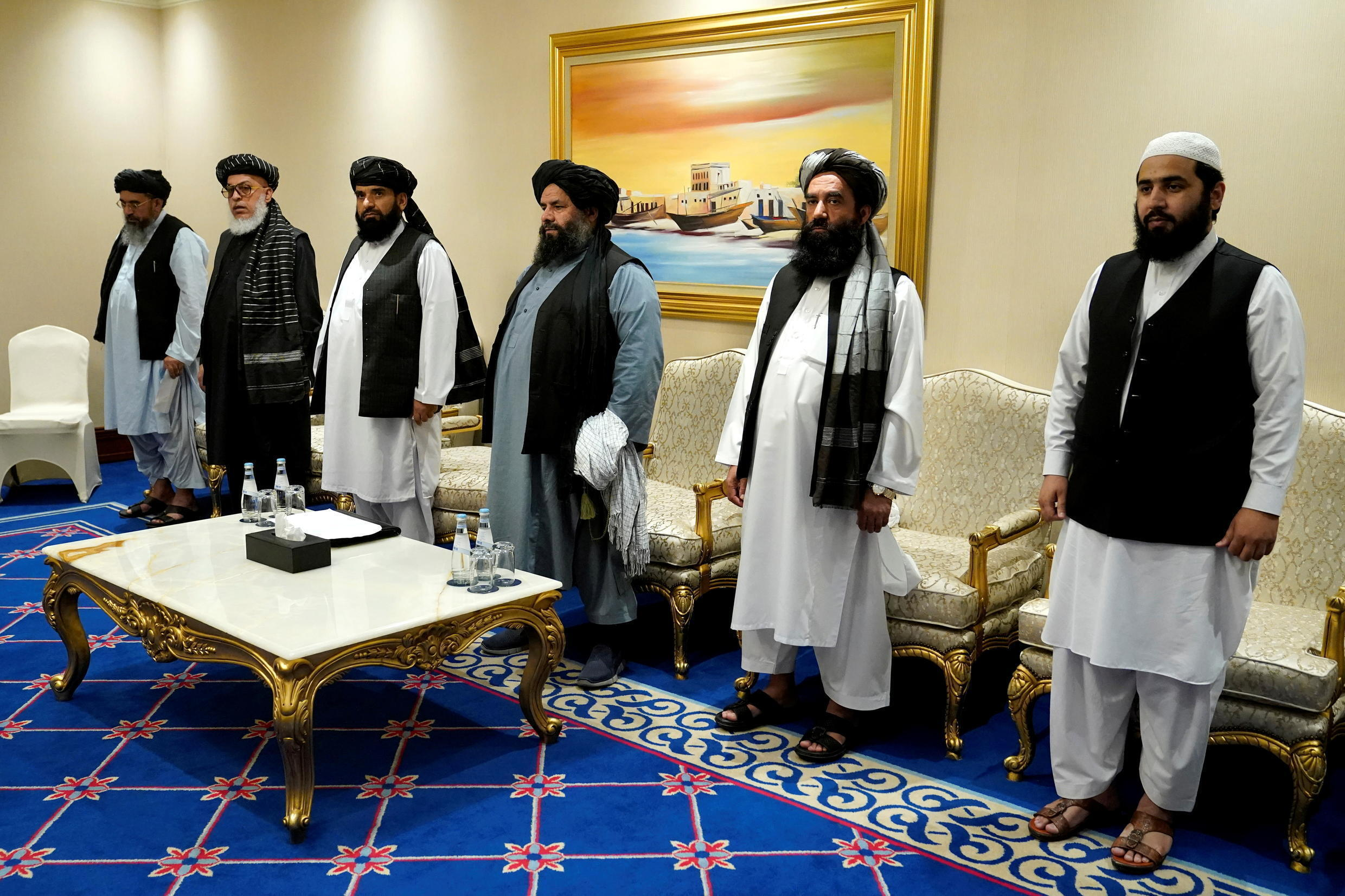 Members of the Taliban peace negotiating team attend a meeting with US Secretary of State Mike Pompeo amid talks between the Taliban and the Afghan government, in Doha, Qatar, November 21, 2020.