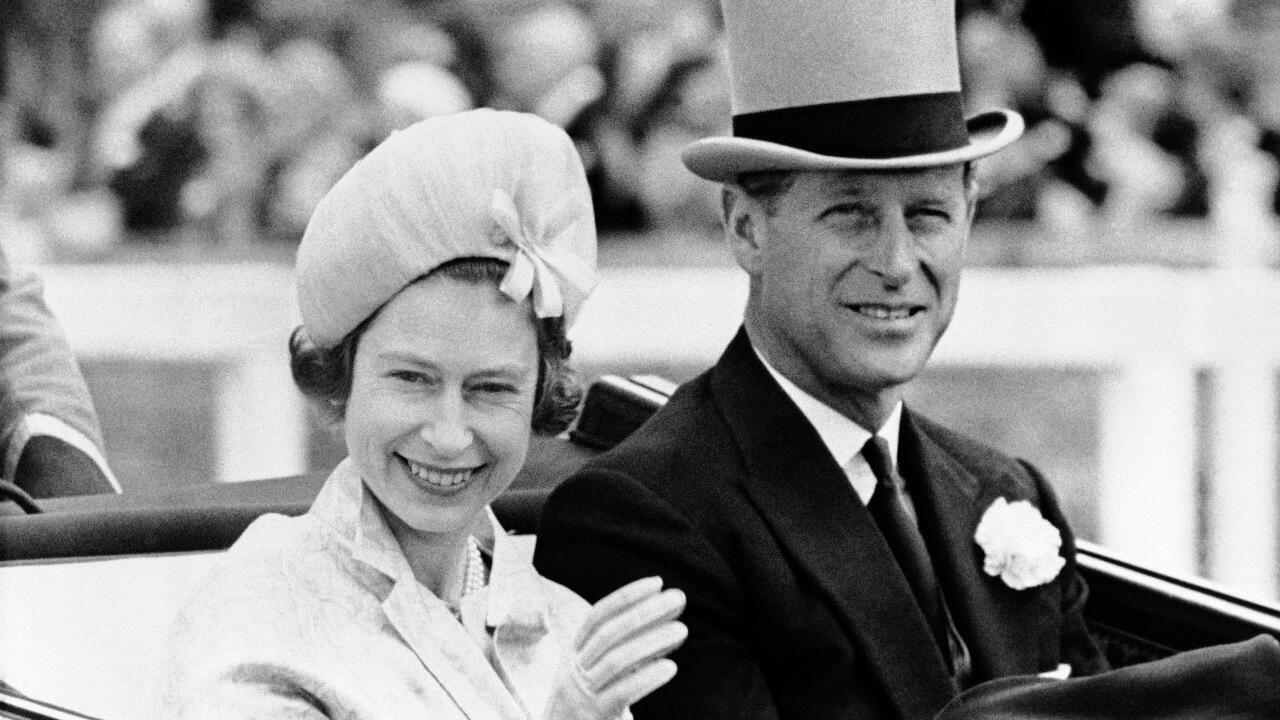 In this June 19, 1962 file photo, Britain's Prince Philip and his wife Queen Elizabeth II arrive at Royal Ascot race meeting, England. Buckingham Palace says Prince Philip, husband of Queen Elizabeth II, has died aged 99.