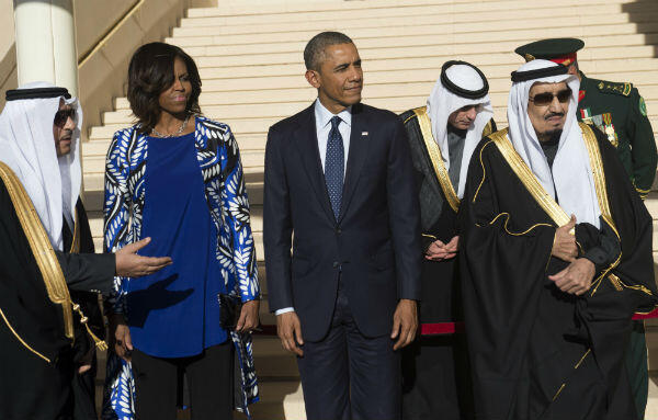 Saudi new King Salman (right) stands alongside then US President Barack Obama (centre) and First Lady Michelle Obama (second from left) in Riyadh on January 27, 2015