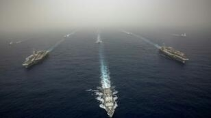 Spanish frigate the Mendez Nunez (centre) had been accompanying the US aircraft carrier USS Abraham Lincoln (left), the aircraft carrier USS John C. Stennis (R) on military exercises before it was recalled