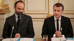 French Prime Minister Edouard Philippe (L) and French President Emmanuel Macron take part in a meeting with New Caledonia representatives in the Murat lounge at the Elysee Palace in Paris, France, October 30, 2017.