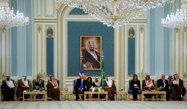 US President Donald Trump (centre-left) and Saudi Arabia's King Salman bin Abdulaziz al-Saud (centre-right) at the Saudi Royal Court in Riyadh, on May 20, 2017. US First Lady Melania Trump is seen sitting at a separate table on the far right.