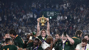 Du Toit holds the Rugby World Cup trophy after South Africa defeated England in the final in Japan last November