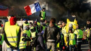 Des Gilets jaunes rassemblés à Caen, en Normandie, le 18 novembre dernier.