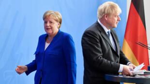 Angela Merkel et Boris Johnson quittant leur conférence de presse commune, le 21août2019, à Berlin.