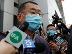 Hong Kong media tycoon Jimmy Lai arrested over pro-democracy march