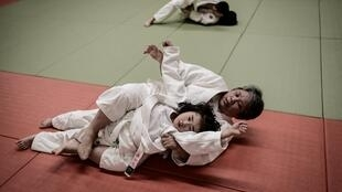 Wakako Ueno, who raised three daughters to become Olympic and world champions, still gets on the tatami at the age of 64 to show girls how to perform the moves