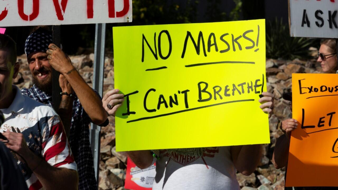 Protestors demonstrate outside the home of Tucson's Mayor Regina Romero in opposition to the new mask mandate to prevent the spread of the coronavirus disease (COVID-19) in Tucson, Arizona, U.S., June 20, 2020.