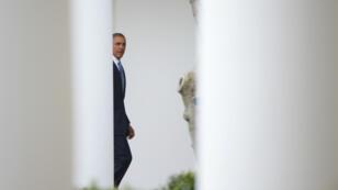 Le bilan politique de Barack Obama, qui quittera ses fonctions dans 12 mois, divise l'Amérique, selon un sondage.