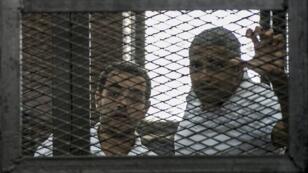 Le Canadien d'origine égyptienne Mohamed Fahmy et l'Égyptien Baher Mohamed lors d'une audience, en juin 2014.