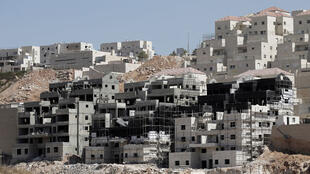 Buildings under construction in an Israeli settlement on the West Bank on September 4, 2014