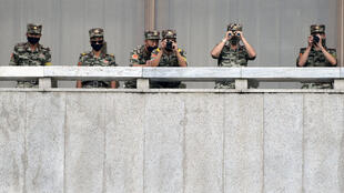 North Korean soldiers keep watch toward the south as South Korean Unification Minister Lee In-young inspects (not pictured) the truce village of Panmunjom inside the demilitarised zone separating the two Koreas, South Korea, September 16, 2020.