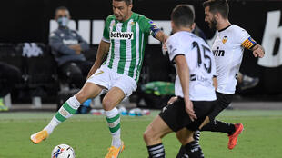Real Betis provisionally moved atop La Liga with a 2-0 victory over Valencia on Saturday, Joaquin Sanchez (L) playing a crucial role in each goal
