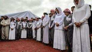 Iraqi Yazidis attended a ceremony to mark the first opening of mass grave containing victims of the Islamic State group in Sinjar region