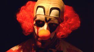 A man dressed in a clown costume