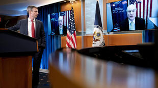 US special envoy for Yemen Tim Lenderking speaks via teleconference during a news conference on February 16, 2021 as State Department spokesman Ned Prices looks on