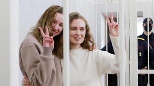 Chultsova, left, and Bakhvalova, shown here flashing the V for victory sign from inside a defendants' cage, had been in pre-trial custody since November