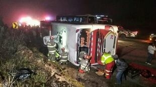 A photo released by the Cuenca Fire Department showing a bus that crashed in Ecuador, killing 11 people