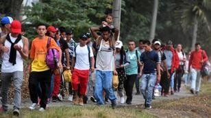 In this file photo taken on April 10, 2019, Honduran migrants hoping to reach the United States leave San Pedro Sula, 300 kms north of Tegucigalpa, to travel to the Guatemalan border
