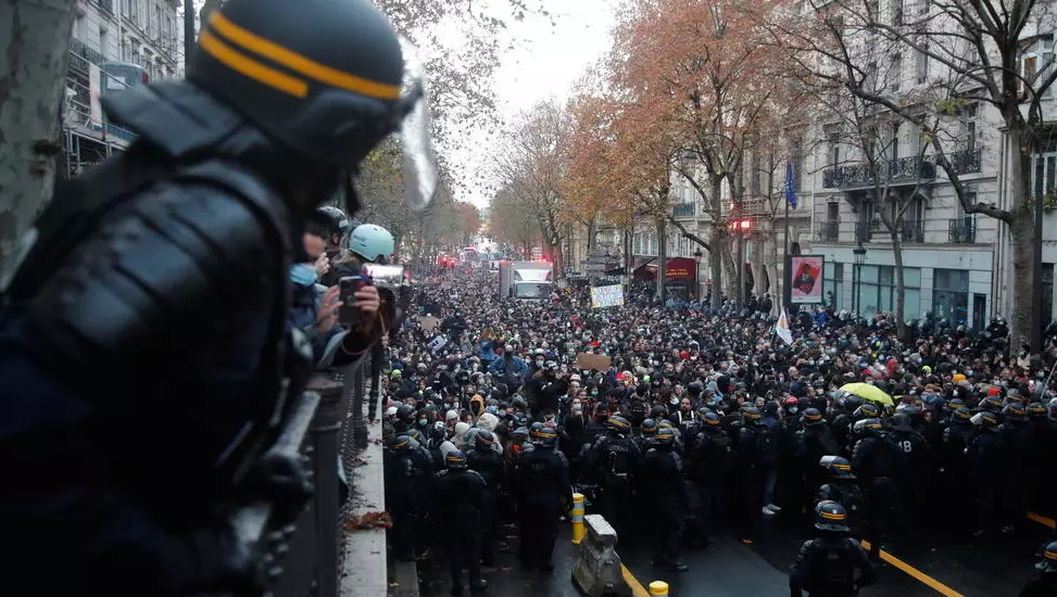 "French CRS riot police gaz out over a demonstration against the ""Global Security Bill' that rights groups say would infringe journalists' freedom in France. Photo taken in Paris on December 12, 2020."
