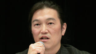 This handout photo taken on October 27, 2010 and released by an international relief organisation on January 21, 2015 shows Japanese journalist Kenji Goto delivering a lecture during a symposium in Tokyo